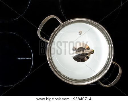 Stewpot on black induction cooker shot from above