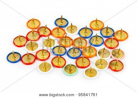 Heap of multicolored pins isolated on white background