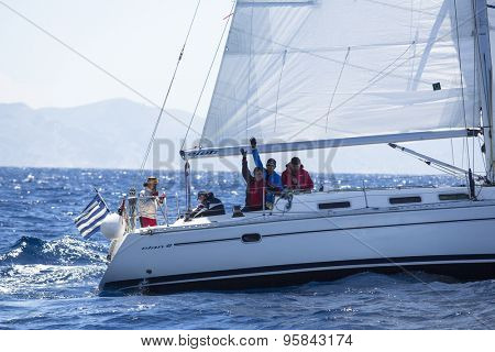 ANDROS - SYROS, GREECE - CIRCA MAY, 2014: Sailors participate in sailing regatta 11th Ellada 2014 among Greek island group in the Aegean Sea, in Cyclades and Argo-Saronic Gulf.