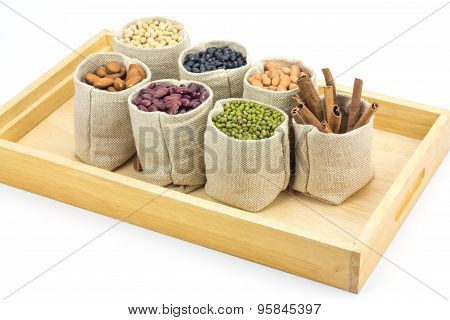 Different Kinds Of Beans And Cinnamon In Sacks Bag On Wooden Tray,selective Focus On Mung Beans