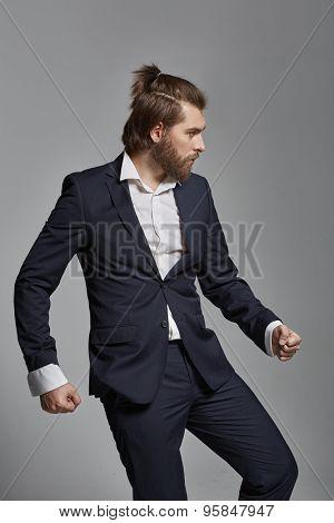 Stylish man with beard wearing suit