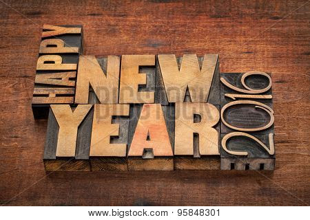 Happy New Year 2016 greetings  - word abstract in vintage letterpress wood type blocks on a grunge wooden background