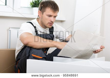 Frustrated Man Reading Instruction