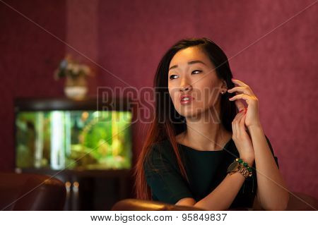 Asian woman indoors