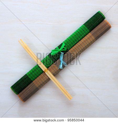 Two Chopsticks On Bamboo Mats