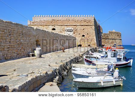 Fishing boats and Venetian Fortress in Heraklion, Crete Island, Greece