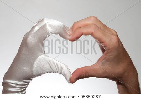 White Elegant Heart Shaped Woman's Glove And  Man's Hand Isolated On White Background
