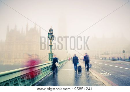Westminster bridge at foggy morning in London