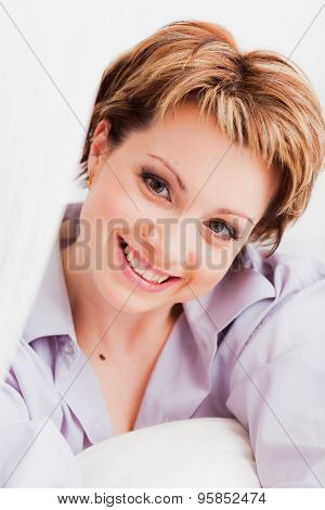 Smiling woman looking straight ahead