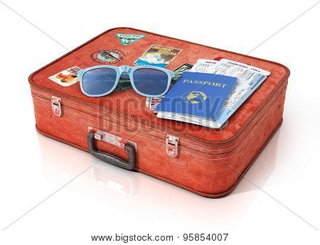 Air tickets in the passport and and sunglass on the vintage suitcase. Travel concept.