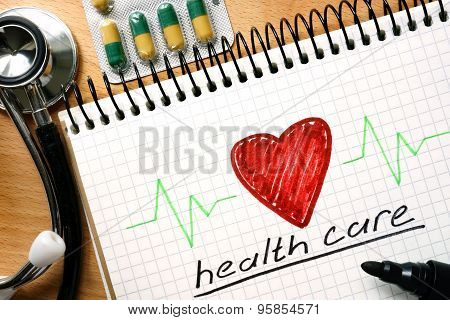 Note with words health care concept.