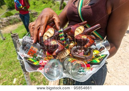 OCHO RIOS, JAMAICA - MAY 07, 2012:  Souvenirs on the glass tray in the hands of the local women