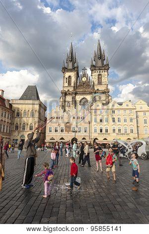PRAGUE, CZECH REPUBLIC - May 08, 2013: A man doing huge bubbles and amazed kids. Street Art.