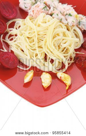 fresh rose wild salmon baked in cream cheese sauce with italian pasta and red hot pepper on square plate isolated over white background