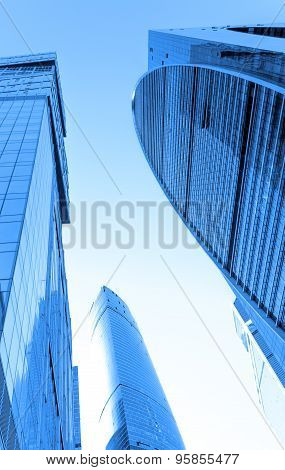 Perspective wide angle view to blue glass building skyscrapers