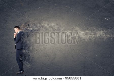 Confused young business man standing and thinking.
