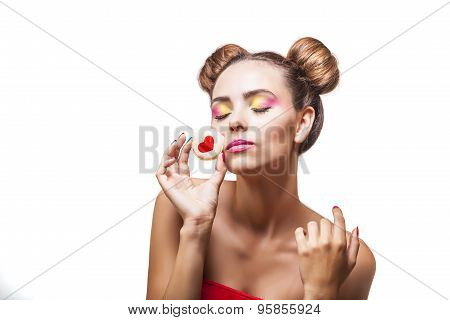 Beautiful Fashion Model Girl With Cookies With Hearts On Pink Background