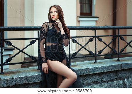 Woman In A Black Dress With Lace.