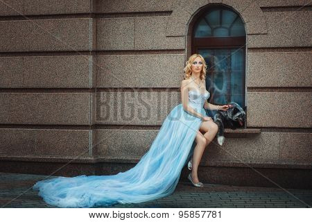 Blonde Girl In A Blue Long Dress.