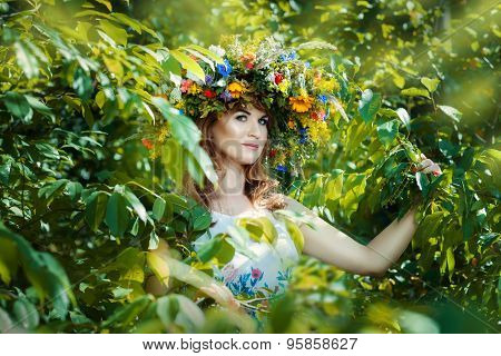 Pretty Woman Among Tree Leaves.