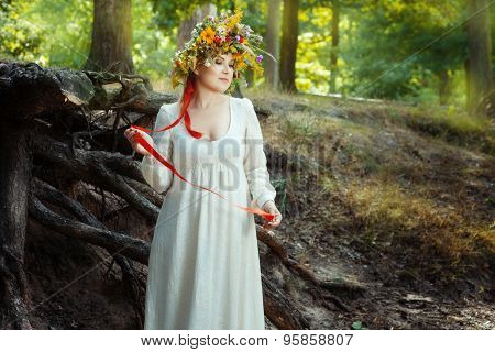 Romantic Girl Standing In The Woods.
