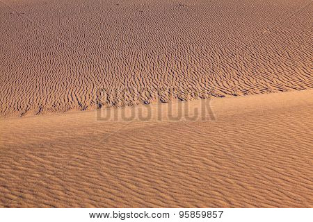 Thin waves on sand. Bright solar morning in picturesque part of Death Valley, USA. Mesquite Flat Sand Dunes