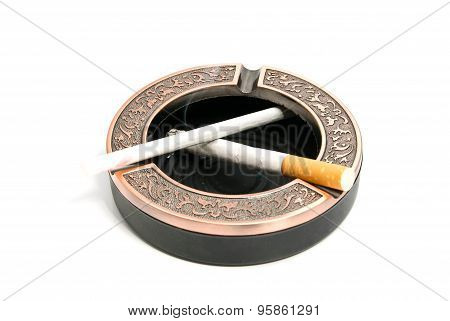 Two Different Cigarettes In Metal Ashtray
