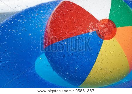 Floating Tire And Beach Ball In The Pool