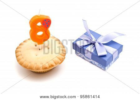 Cupcake With Eight Years Birthday Candle And Gift On White