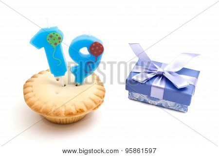 Cupcake With Nineteen Years Birthday Candle And Gift