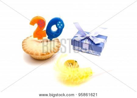 Cupcake With Twenty Years Birthday Candle, Gift And Whistle