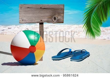 Beach Ball And Wooden Signboard