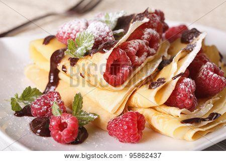 Beautiful Crepes With Raspberries And Chocolate Macro. Horizontal