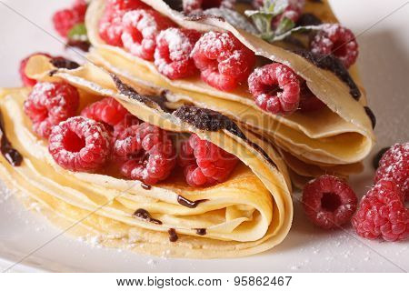 Raspberry Crepes With Chocolate Frosting Macro On A Plate. Horizontal