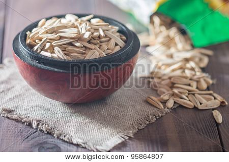White Sunflower Seeds In Wooden Bowl