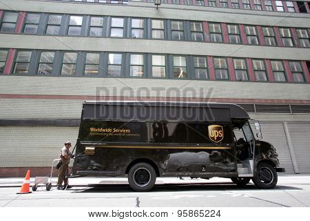 NEW YORK CITY - FRIDAY, JUNE 19, 2015: An United Parcel Service (UPS) delivery truck and a driver in Manhattan.