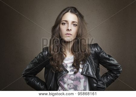 Attractive Brunette Young Girl On Textured Warm Background