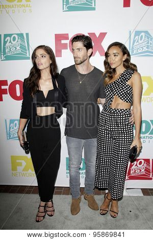 SAN DIEGO - JUL 10:  Janet Montgomery, Iddo Goldberg, Ashley Madekwe at the 20th Century Fox Party Comic-Con Party at the Andaz Hotel on July 10, 2015 in San Diego, CA