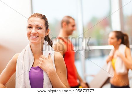 Portrait of a young woman in a fitness club