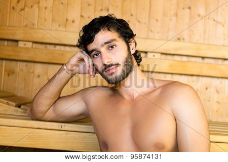 Portrait of a man relaxing in a sauna
