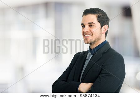 Portrait of a smiling businessman. Copy-space on the bright background