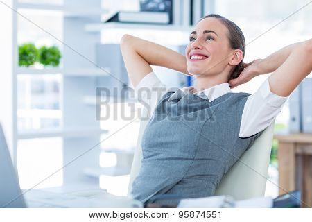 Businesswoman relaxing in a swivel chair in office