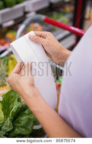 Close up view of woman reading her shopping list