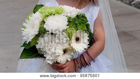 Flower girl holding bouquet