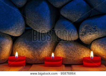 Candles Are Lit On The Background Of The Sauna Stones. Preparing For The Ceremony Bathhouse
