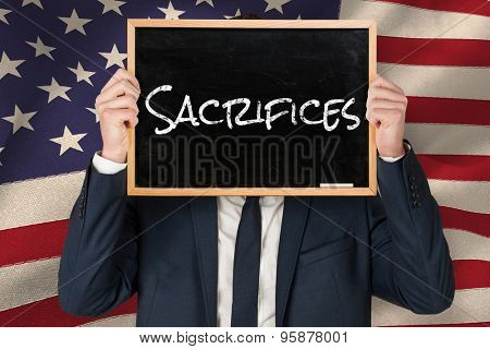 Businessman holding board against united states of america flag