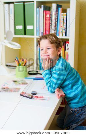 Cute Little Boy Studying