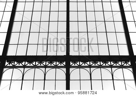 Aged Glass And Metallic Building Facade In Black And White