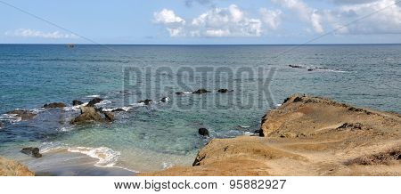 Small Beach By The Rocks