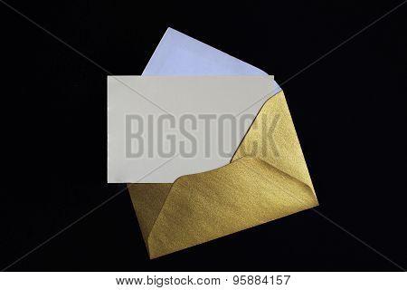 Opened Golden Envelope On Black Background
